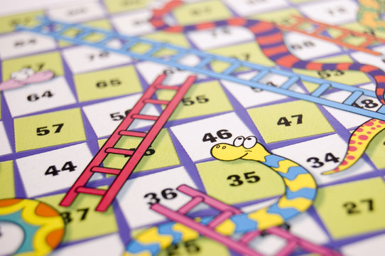 detail of snakes and ladders game board