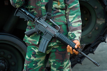 Soldier with M-16 military rifle
