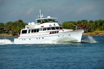 yacht entering ocean inlet