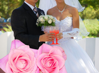 Couple pink roses and just married couple on background