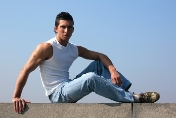 Sitting Sexy Man with Blue Sky behind