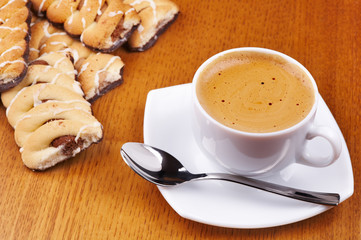 Cup of coffee and pastry