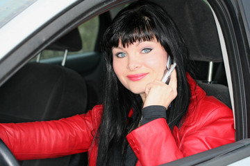 woman is calling by mobile phone in a car