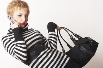 Nice blondgirl standing with black bag