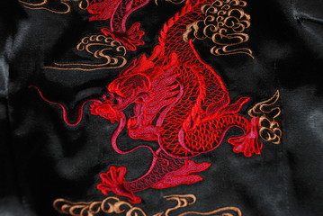 Red dragon on the black atlas