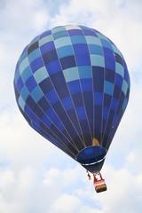 Big blue balloon in diagonal