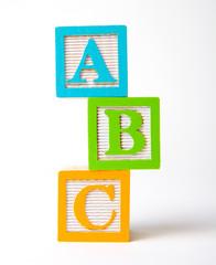 Wooden alphabet blocks stacked