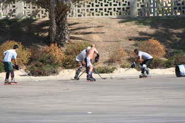 men playing roller hockey