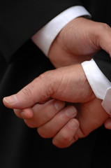 The hands of a businessman waiting a decision