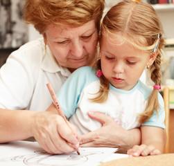 Grandma and grand-daughter painting