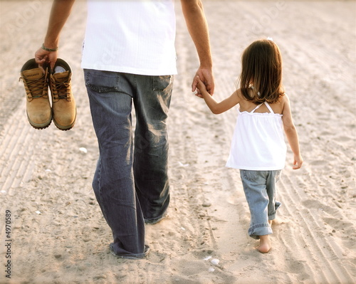 Daddy Walking Through The Sand With His Little Girl Stock Photo And