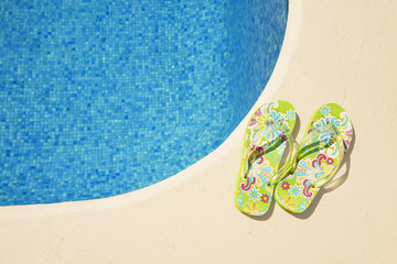 vibrant green flip-flops at the poolside