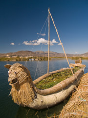 Floating Uros Island boats on Lake Titicaca in Peru