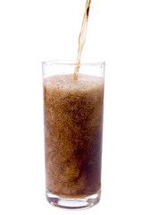 Pouring cola in to the glass