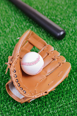 Baseball equipment against green grass
