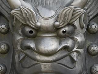 Iron face statue