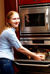Lady infront of a open oven