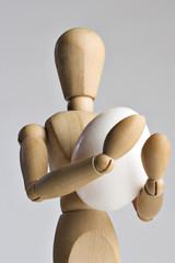 Mannequin holding an egg