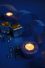 blue candles and ribbon