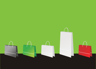 Shopping bags on green background