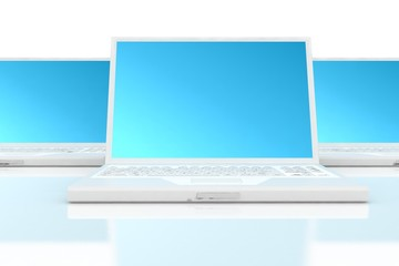 three white laptops