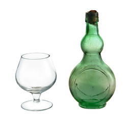 Small wine bottle and glass on white background