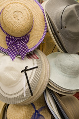 A rack of ladies straw hats on display.