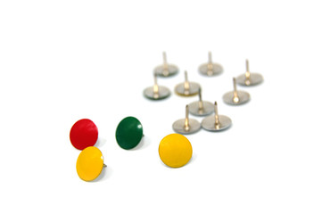 Coloured drawing pins isolated on white