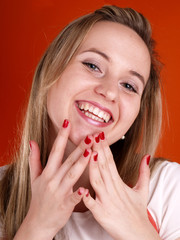 woman with fingers over her face