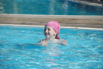 The happy child in pool