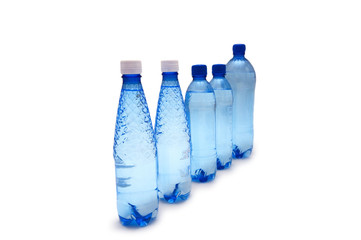Row of water bottles isolated on white
