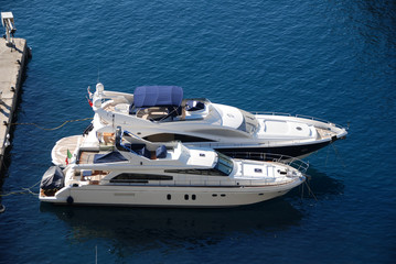 Expensive boats docked at exclusive marina