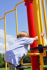 Boy Climbing at the Park