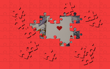 red puzzle pieces cover ace of hearts