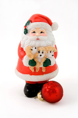 Santa Claus and a red ball isolated on white