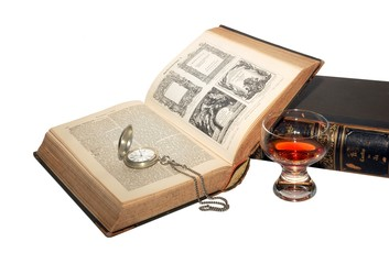 The ancient books with watch isolated over a white background