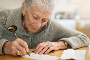 Senior woman writing
