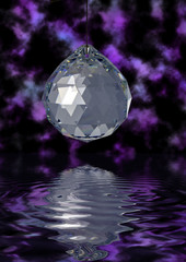 Christmas decoration, crystal ball reflecting in water