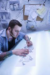 Man creating tattoo.