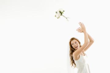 Bride tossing bouquet.