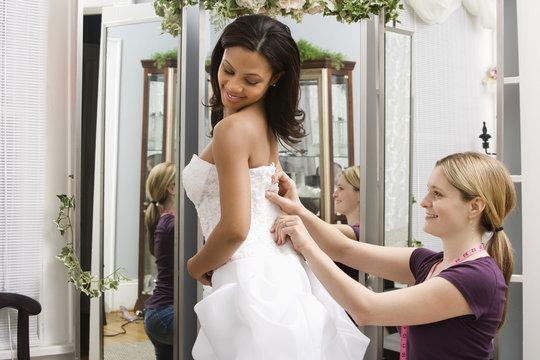 Seamstress helping bride.