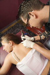 Woman getting tattoo.