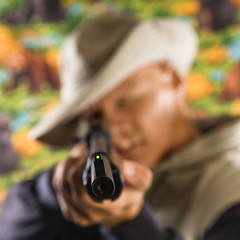 Man pointing rifle.