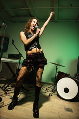 Female singing into mic.