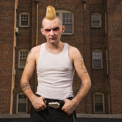 Portrait of a punk outside.
