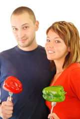 happy couple with peppers isolated