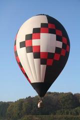 White-red-black balloon go down