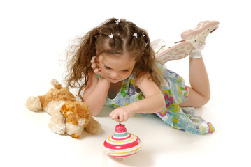The little girl plays