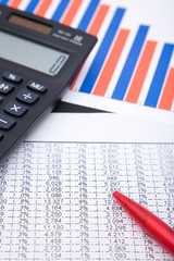 office desk with a calculator and business charts, shallow dof