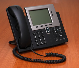IP Phone standing on a table